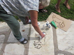 Creating Ephemeral Artwork with dirt and stencils of endangered species
