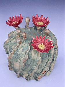 A sample centerpiece = pottery cactus in bloom