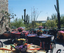 Tables prepared for an event on the Ironwood Terraces