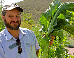 Educator with native crop